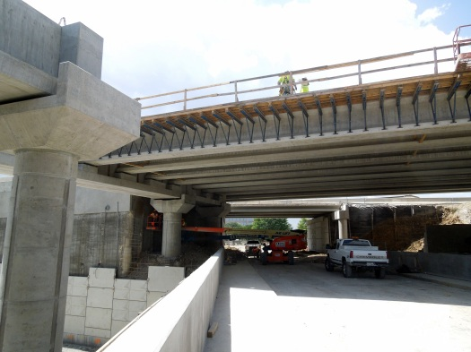 (Summer 2014) A closed Valley View Ln. underpass, post-excavation west of Midway, and showing the new cross bridge.