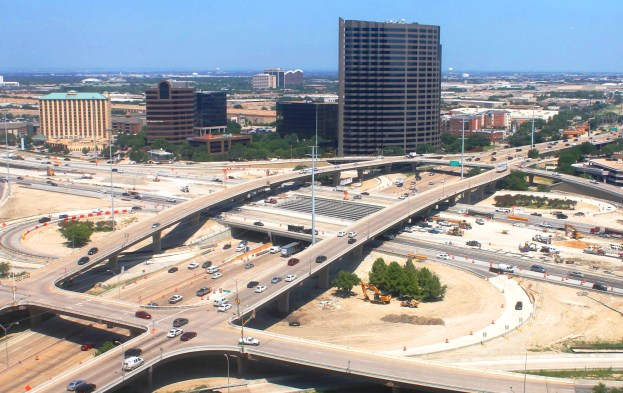 Photo of the Dallas North Tollway, Fri. July 25, 2014. View from the south side, overlooking the newly-set beams along I-635, where panels will be placed next week. Beam setting over the DNT were completed end of June.